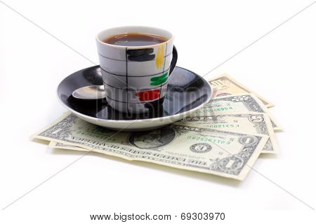 cup of the coffee and dollars
