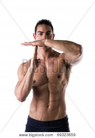 Fit Man Gesturing Time Out Sign
