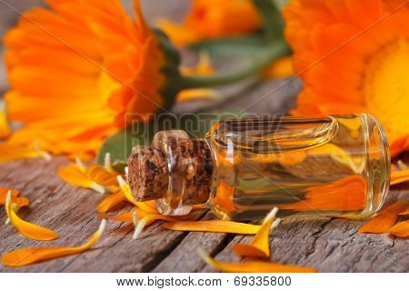 Calendula Tincture And Flowers On An Old Table Horizontal
