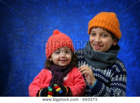 Brother And Sister Having Fun In Winter