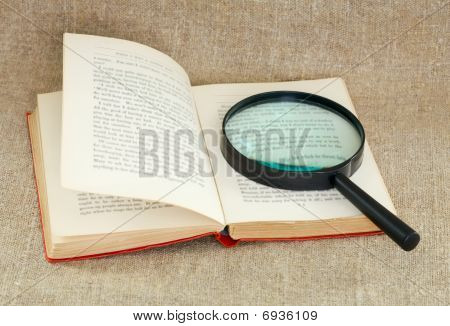 Still Life Of Magnifying Glass And Old Book