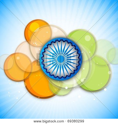 Blue Asoka Wheel and saffron and green colors circle on blue background for 15th of August, Indian Independence Day celebrations.