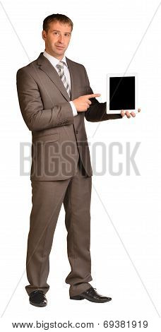 Businessman holds tablet pc