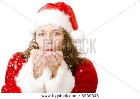 Santa Claus Woman Is Blowing Christmas Snow
