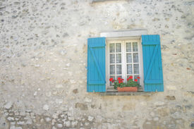 Window With Blue Shutters And Red Flowers