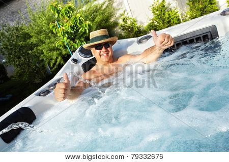 Man having massage in  hot tub Jacuzzi. Spa background.