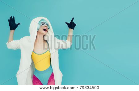 Screaming Crazy Girl In Hoodie On A Blue Background.