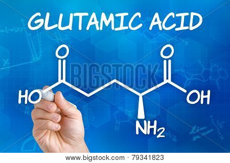 Hand with pen drawing the chemical formula of glutamic acid
