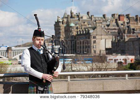 Scottish Bagpiper In Edinburgh
