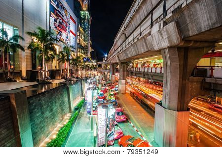 BANGKOK, THAILAND - JULY 29, 2007: Queue of taxis waiting for customers near the Siam Paragon Shopping Centre. Siam Paragon - one of the largest shopping centers in Asia, opened on 12/09/2005
