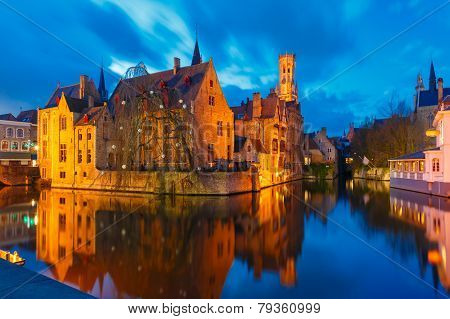 Cityscape With A Tower Belfort From Rozenhoedkaai In Bruges At Sunset, Belgium