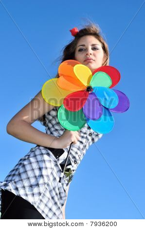 Girl Holding Windmill
