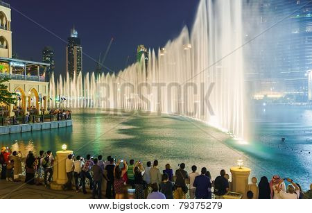 DUBAI - OCT 15: The Dubai Fountain on October 15, 2014 in Dubai, UAE. The Dubai Fountain is the world's largest choreographed fountain system set on the 30-acre manmade Burj Khalifa Lake