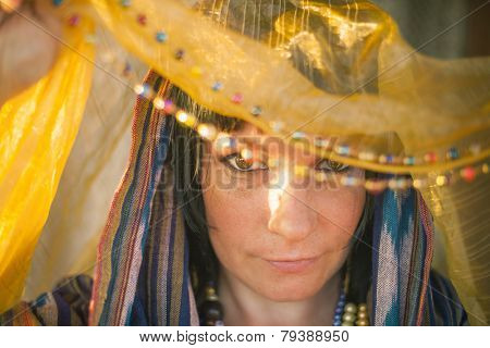 Young woman in a chador in the soft rays of the sun.