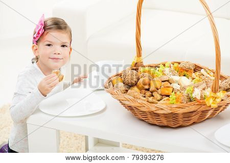 Cute Little Girl With Pastry