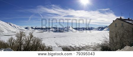 panoramic view of snowy plateau of Castelluccio of Norcia Umbria Italy winter