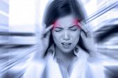 Headache migraine people - Doctor woman stressed. Woman Nurse / doctor with migraine headache overworked and stressed. Health care professional in lab coat wearing stethoscope at hospital. poster