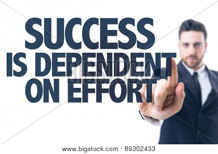 Business man pointing the text: Success is Dependent on Effort