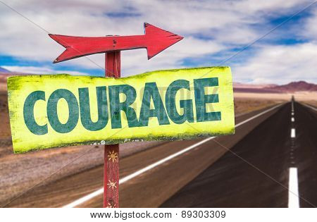 Courage sign with road background