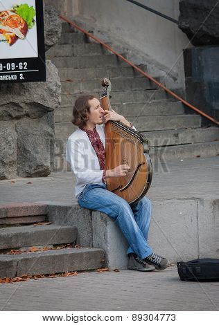 Ukraine, Kiev - September 11, 2013: Young Man In Traditional Costume Playing The Bandura