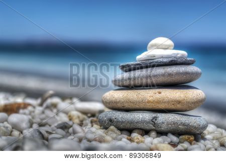 Stones Pile On White Pebbles By The Shore