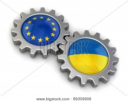 Ukrainian and European union flags on a gears (clipping path included)