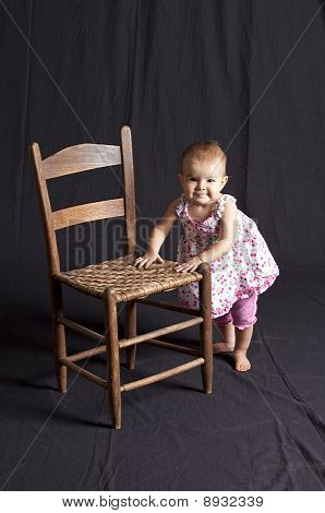 Baby Girl And Chair