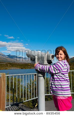 Young Girl Standing Next To Telescope