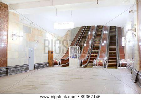 MOSCOW, RUSSIA  -  APRIL 12, 2015: Sokolnicheskaya line - the first line of the Moscow metro. Station of the Moscow metro station Krasnye Vorota escalator exit to the city