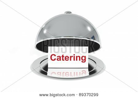 opened silver cloche with white sign catering