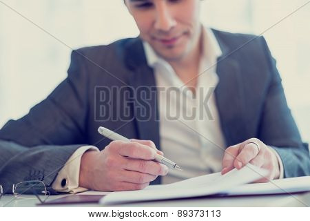 Lawyer Or Businessman About To Sign A Contract Or Agreement