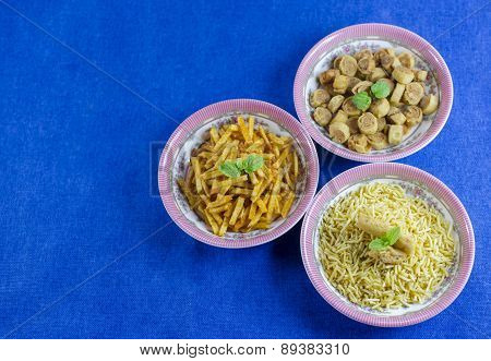 Different types of fried snacks such as bhujia made from gram flour and bhakarwadi poster