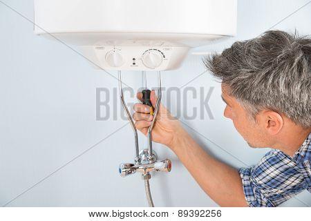 Plumber Repairing Water Heater
