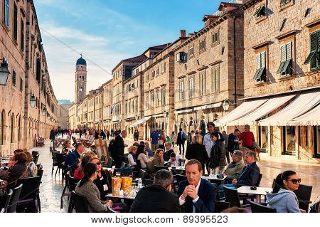Tourists enjoy the terraces of restaurants in the old town of Dubrovnik
