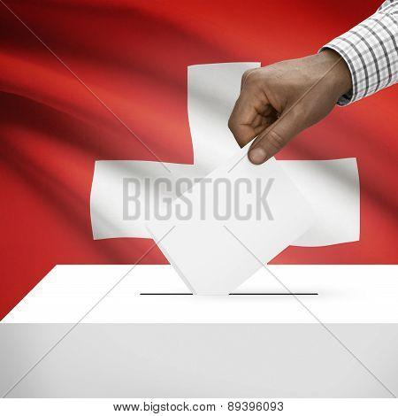 Ballot Box With National Flag On Background - Switzerland