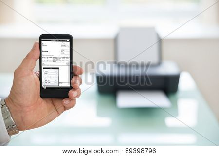 Person Using Cellphone For Printing Invoice
