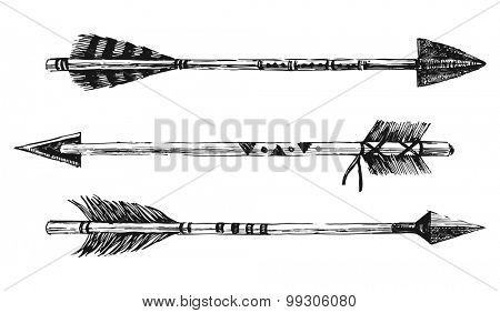 3 hand drawn arrows in tribal style on white background