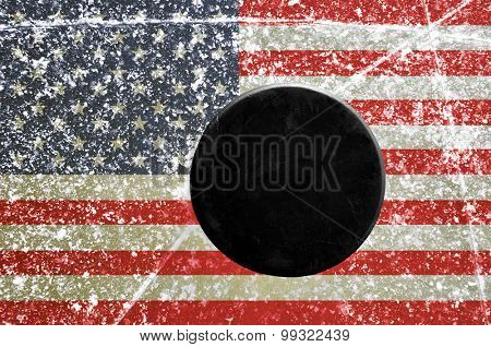 Black hockey puck on ice rink with flag of the United States poster