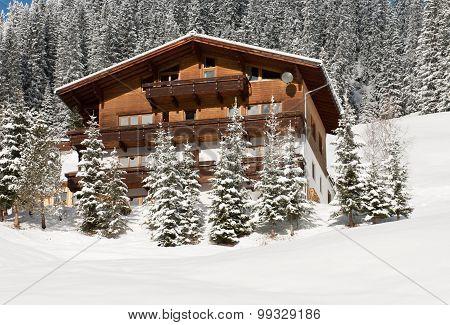 A Chalet On The Side Of A Mountain, Near The Village Of Warth-Schrocken, In Austria