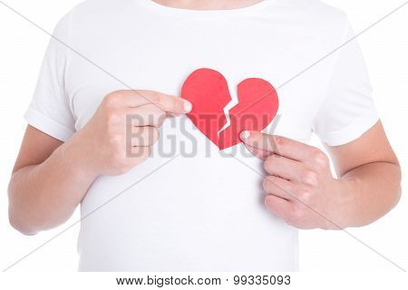 Love Concept - Man Holding Two Halfs Of Broken Heart Isolated On White