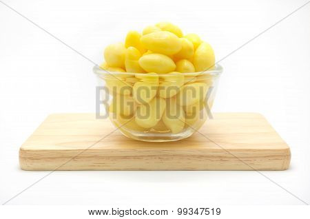 Ginkgo nut in wooden plate on white