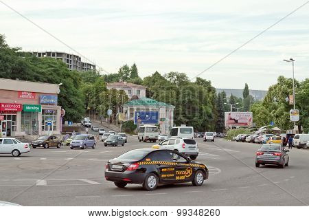 Taxi At The Roundabout Road Junction In The Centre Of The City