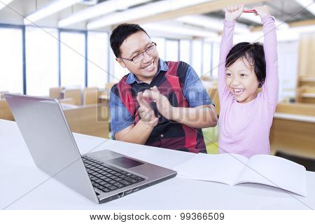 Cheerful Student Celebrating Her Success With Teacher