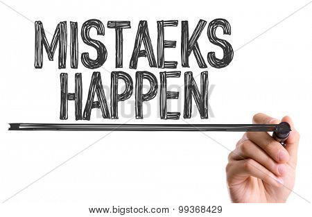Hand with marker writing the word Mistaeks Happen