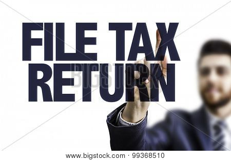 Business man pointing the text: File Tax Return