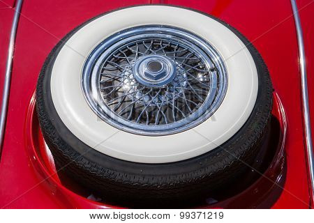Close up of spare tire on an red retro vintage car