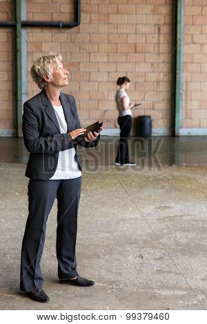 Realtor And Workmate Are Survey A Warehouse
