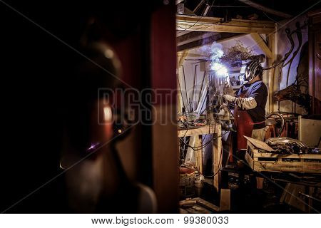 Metal Worker Standing In Workshop