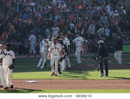 Giants Players Celebrate Win By Giving Each Other High Fives