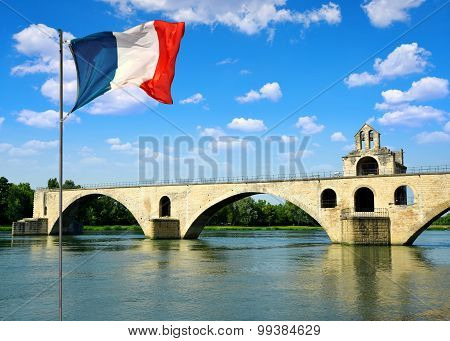 Pont Saint-Benezet with French flag in Avignon, France poster